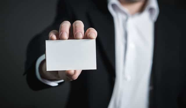 Person holding out his business card